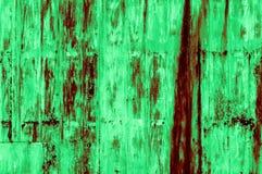Vieux fond verdâtre-rougeâtre rouillé de mur de fer images stock