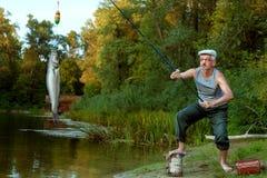 Vieux grand-père en voyage de pêche Photo libre de droits
