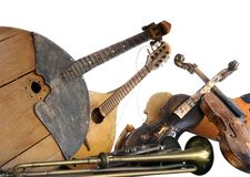 Vieux instruments de musique cassés Image stock