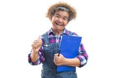 Vieux jardinier asiatique heureux sur un blanc Photos libres de droits