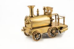 Vieux jouet d'or de locomotive à vapeur Image stock