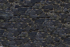 Vieux lisse en pierre gris-foncé de toile d'ardoise de fond composé de tuiles photographie stock