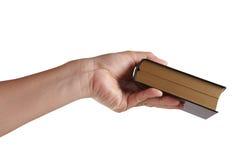 Vieux livre avec la main Photos libres de droits