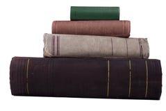 Vieux livres de pile d'isolement sur le blanc Photographie stock