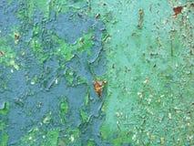 Vieux métal rouillé avec le fond bleu trois de peinture image stock
