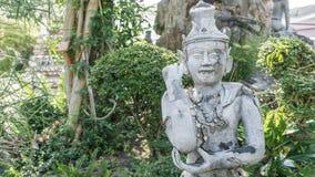 Vieux man& antique x27 ; statue de visage de s dans le style asiatique Photos stock