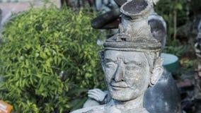 Vieux man& antique x27 ; statue de visage de s dans le style asiatique Image stock