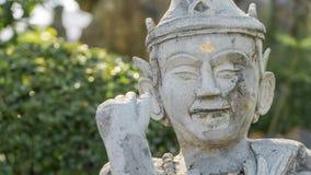 Vieux man& antique x27 ; statue de visage de s dans le style asiatique Images libres de droits