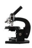 Vieux microscope noir d'objectifs du classique quatre d'isolement sur un fond blanc Photos libres de droits