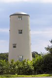 Vieux moulin à vent rénové Photographie stock libre de droits