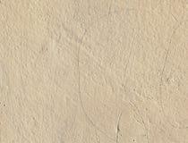 Vieux mur beige de plâtre Image libre de droits