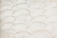 Vieux mur blanc avec des échelles de poissons Photographie stock libre de droits