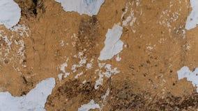 Vieux mur d'argile, hutte de boue, argile criqué Images stock
