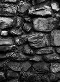 Vieux mur de monastère fait en texture 3d, fond verticale de grand b&w de roches Photographie stock