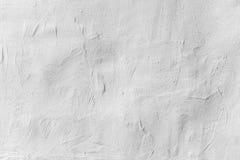 Vieux mur en béton blanc avec le plâtre, texture de fond Photographie stock libre de droits