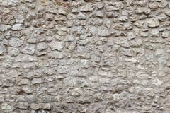 Vieux mur en pierre et ciment Fond en pierre Mur en pierre de Cracovie image libre de droits