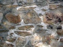 Vieux mur ensoleillé de roche Photographie stock