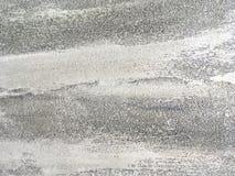 Vieux mur gris couvert de plâtre inégal Texture de la surface en pierre argentée minable de vintage, plan rapproché Photos stock