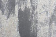 Vieux mur Porte en métal de texture il a été peint dans gris-foncé usage léger Photographie stock