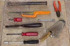 Vieux outils sur le plancher Photos libres de droits