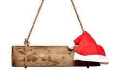 Vieux panneau indicateur avec le chapeau de Santa Images stock