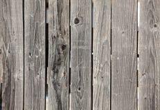 Vieux panneaux en bois gris de barrière Photographie stock libre de droits