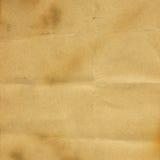 Vieux papier brûlant et plié. Images stock