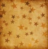 Vieux papier décoré des étoiles grunges Image libre de droits