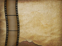 Vieux papier dans le type grunge avec le filmstrip Image stock