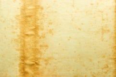Vieux papier jaune avec la souillure du côté gauche Images libres de droits