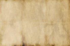 Vieux papier parcheminé usé Photographie stock libre de droits