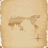 Vieux papier sur la carte du monde Photo stock