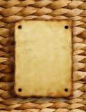 Vieux papier sur la texture en osier Images stock