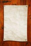 Vieux papier sur le bois Images stock