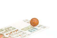 Vieux penny et livre irlandais Images stock