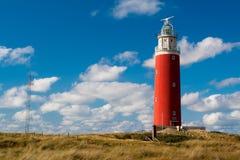 Vieux phare sur un bord de la mer Photos stock