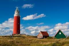 Vieux phare sur un bord de la mer Photographie stock libre de droits