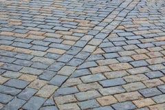 Vieux plan rapproché de trottoir de pavé rond Images stock