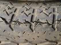 Vieux pneu criqué Photographie stock libre de droits