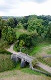 Vieux pont féerique antique de pierre de tsale dans la perspective isométrique Image libre de droits
