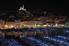 Vieux Port of Marseilles at night. A night scene of Le Vieux Port of Marseilles with basilica Notre Dame de La Garde Royalty Free Stock Image