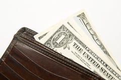 Vieux portefeuille avec des billets de banque des dollars US à l'intérieur Photo stock