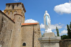 Vieux Pouzauges Church with a statue of Virgin Mary in the foreground, Pouzauges, Vendee, France Royalty Free Stock Photos
