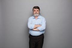 Vieux professeur avec les cheveux gris Photographie stock