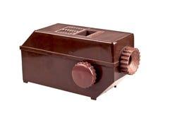 Vieux projecteur de diamètre de brun sur le blanc Photographie stock libre de droits