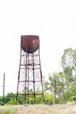 Vieux réservoir d'eau pour un vieux train de vapeur Image libre de droits