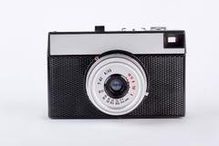 Vieux rétro appareil-photo d'isolement sur le fond blanc images libres de droits