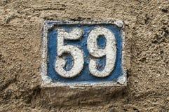 Vieux rétro numéro de plaque 59 de fonte Image libre de droits