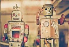 Vieux robots classiques de jouet de bidon Photographie stock libre de droits