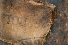 Vieux sac hessois sale de sac embouti utilisé comme matériel de tapisserie d'ameublement Photo stock